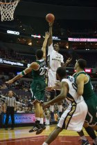Isaiah Armwood puts up a shot in a 67-55 GW win over Manhattan in the 2012 BB&T Classic.