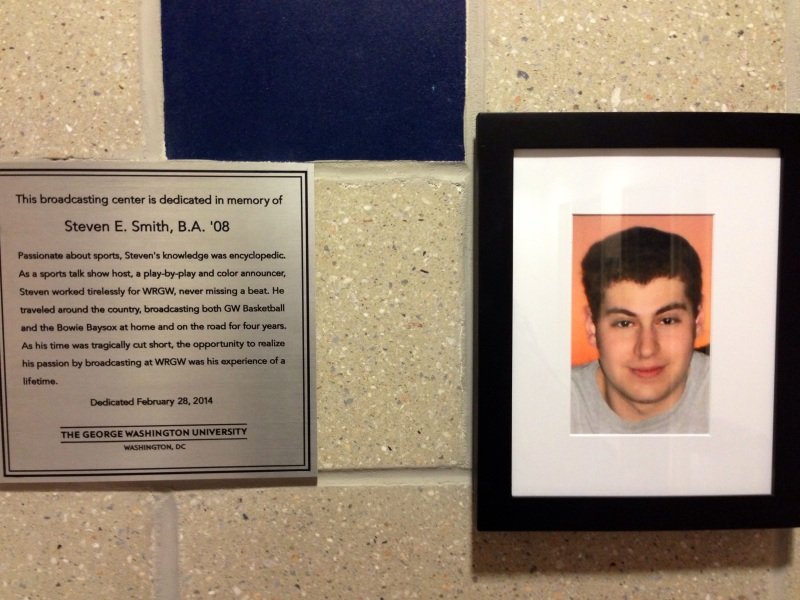 Plaque and picture honoring Steven E. Smith outside of the Steven E. Smith Broadcasting Center